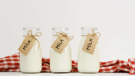 Three bottles of milk on white background. Family healthy habits. Organic dairy products and proper nutrition