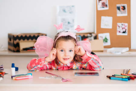 little smiling girl child art space portrait concept. happy childhood. cute and talented little princess. Stock fotó