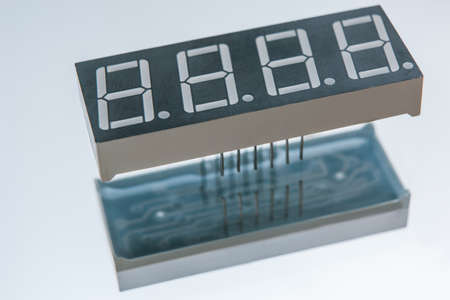 electronic clock display on white background. components and properties of the device chip