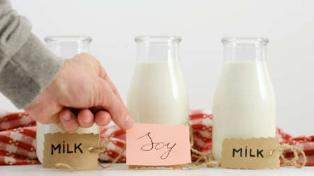 Various milk types. Soy and cow milk. Healthy drinking and vegan lifestyle alternative