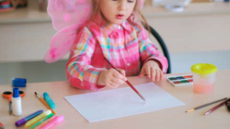 hardworking little cutie on art lessons. creative process. lifestyle of talented people. Stock Photo