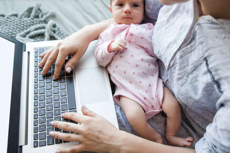 lifestyle of modern business mom. newborn baby not a hindrance to working overtime. daily routine of hardworking people.