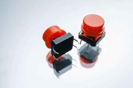 red electronic buttons on white background. drive element of pushbuttons and switches