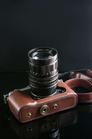 photo camera on black background. hipster paradise. lifestyle of creative people. mirrorless equipment. free space concept