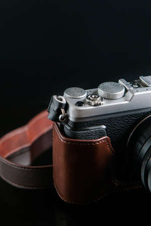 camera repairs black background concept. professional mending of photo equipment. technology innovation.
