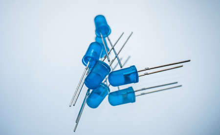 blue light emitting diode on white background. active electronic element. creates optical radiation