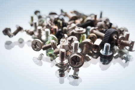screws assortment for computer on white background. fixing elements used in the assembly of electronic devices