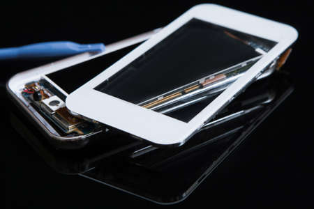 smartphone repairs workshop on black background. mending of smartphones, gadgets and electronic devices