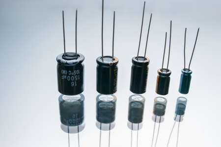 Bipolar electric capacitors on white background. microelectronic component. construction of two electrodes