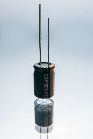 Bipolar electric capacitor on white background. microelectronic component. construction of two electrodes Reklamní fotografie