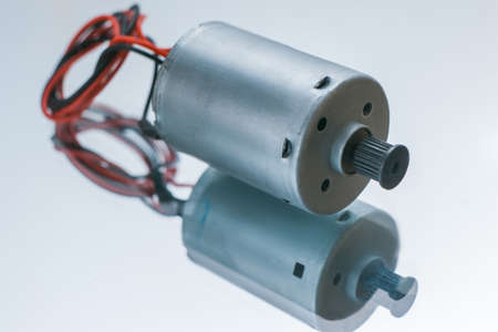 Cylindrical electrical motor on white background. conversion of electrical energy into mechanical Foto de archivo