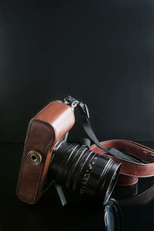 Photo camera on black background. hipster paradise. lifestyle of creative people. mirror less equipment. free space concept