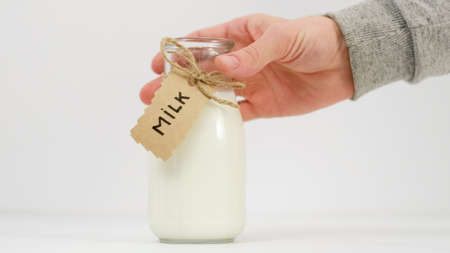 Fresh milk concept. Buy organic products at farmers markets. Best quality goods for your child Stock Photo