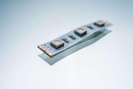 흰색 배경에 LED 테이프입니다. 연성 인쇄 회로 기판. 전자 조명 스트립 스톡 콘텐츠