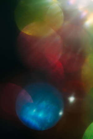 Lens flare. colorful abstract. bokeh light on black background. ray leak