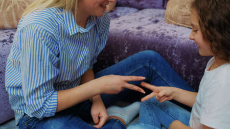 family game time. love bond emotion pastime leisure. mother and child playing rock paper scissors. draw Stock Photo