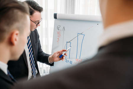 business presentation. office meeting. company ceo talking about company perspective results and established goals Stock Photo