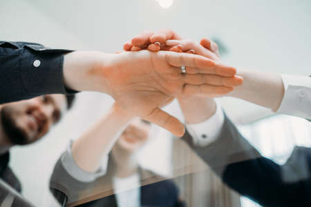teamwork cooperation unity. business people hands together. strength partnership. joined forces to make a prosperous and successful company Stock Photo