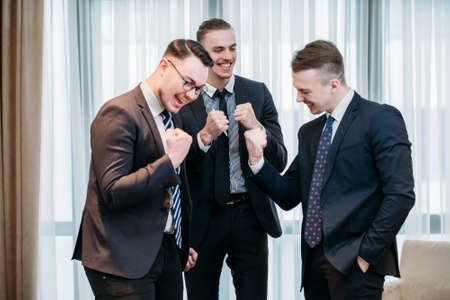 yes, its a business success. happy smiling managers celebrate profitable deal or company financial growth. Imagens