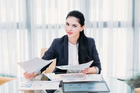 business lady at work. company manager. woman looking through documents in office. professional corporate dresscode