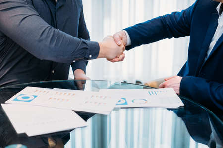 closing or sealing a deal. business partners shaking hands. cooperation partnership, trust joint venture concept