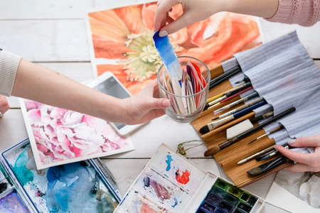 painting art classes. drawings creation. color swatches. watercolor palette and brushes.