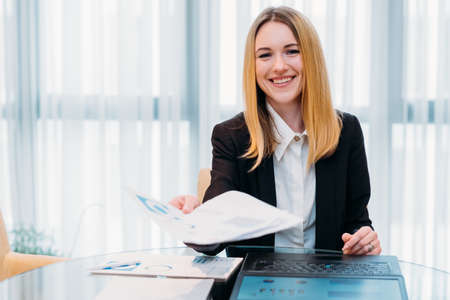 job interview. employment and career concept. business woman holding a resume or an application form. friendly recruiter in office workspace. Stock Photo