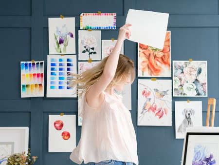 crafty room. artful studio. creative painter workspace. paintings watercolor drawings on the wall. artist dancing