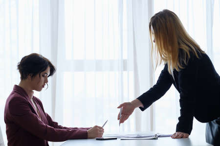 boss reproaching her employee. business woman getting a reprimand from chief manager. superior and subordinate professional relationship. Stok Fotoğraf