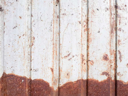 profiled metal sheet background. weathered rusted dented surface. industrial abstract design. copy space concept
