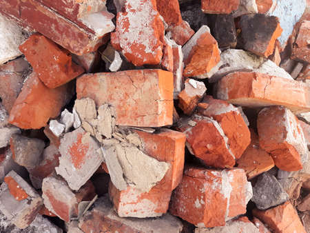 red brick background. scattered old broken shabby blocks. copy space concept