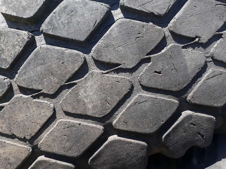 tire tread pattern background. auto car black rubber texture design. worn aged used print. copy space concept