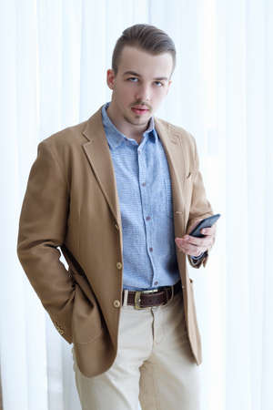 serious confident purposeful ambitious young business man. casual stylish formal wear