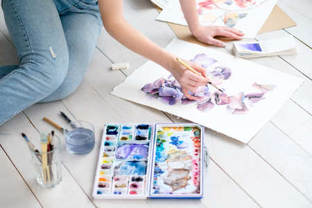 drawing skills. gifted talented artful personality. painting leisure. woman creating a watercolor picture