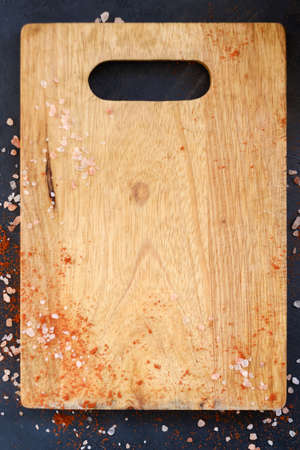 wooden cutting board and flakes of salt and red pepper. food cuisine cooking and culinary process concept. copyspace