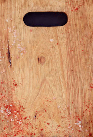 wooden cutting board and flakes of salt and red pepper. food cuisine cooking and eating concept. copyspace
