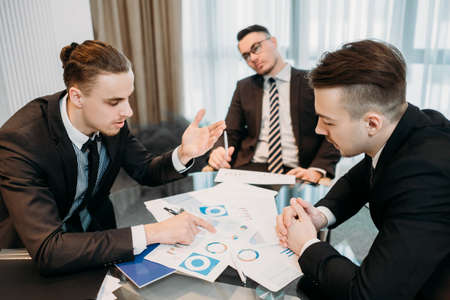 tired of business. vacant blank look. indifferent uninterested ineffective worker. professional inefficiency. unconcerned man bored at company meeting. Stock Photo