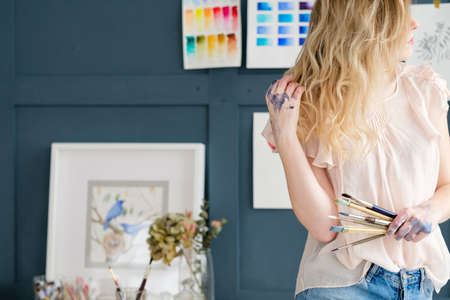 creative leisure. painting hobby. artful personality. painter holding brushes. hands covered with ink dyes colors 스톡 콘텐츠
