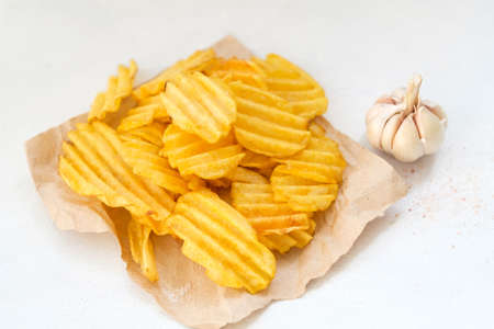 junk fast food and unhealthy eating. crispy chips. crunchy potato crisps on white background Standard-Bild