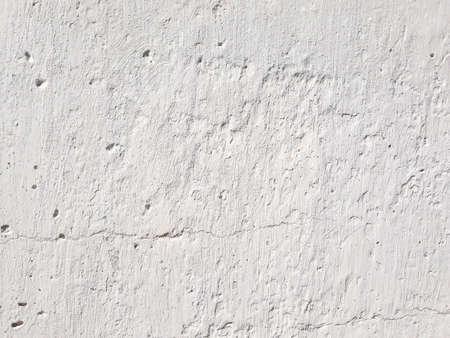 white abstract stucco background. smudged shabby weathered concrete plaster backdrop. copyspace concept