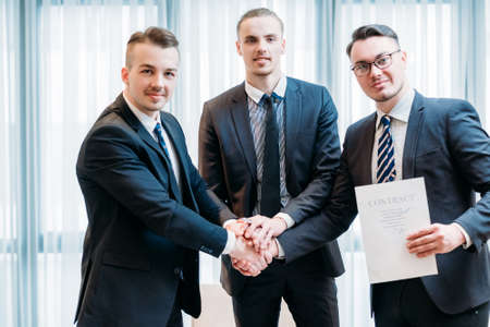 teamwork unity and cooperation result in deal closing or sealing. contract partnership trust joint venture concept. business partners shaking hands. Stock Photo