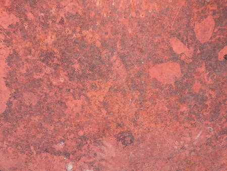 abstract art textured weathered rough background. distressed scratched grungy design. red and dirty blotches surface. free space concept Banco de Imagens