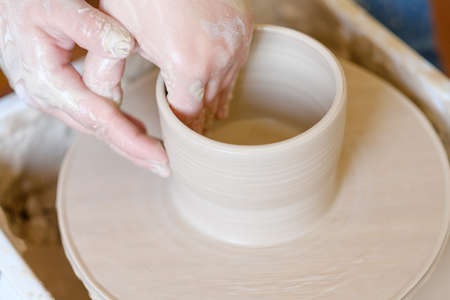 pottery workshop. handmade craft. artisan forming and shaping clay on potter wheel 스톡 콘텐츠