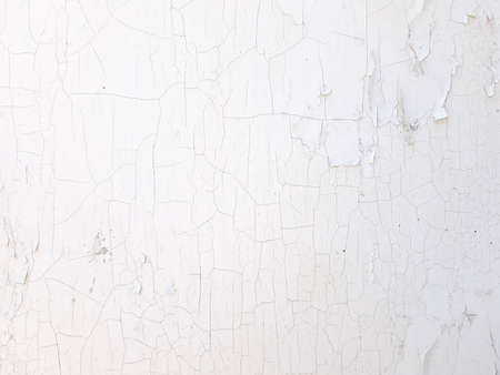 shabby old flaky plaster wall background. white damaged crackled paint. weathered worn out surface. copyspace concept