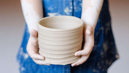 pottery handcraft hobby. hands showing freshly made crock pot