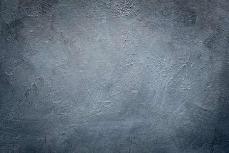 abstract art blue grey textured background. distressed dark scratched design. dark edges vignette. free space concept
