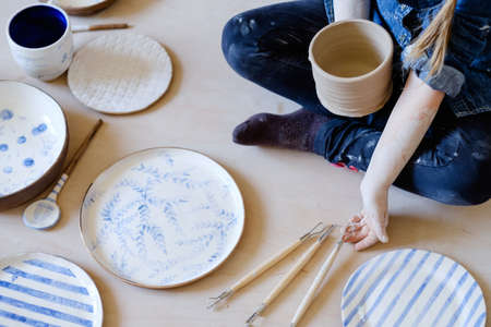 pottery instruments. creative hobby. handmade crockery. craft clay plates with painted simple design