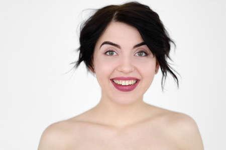 emotion face. happy smiling joyful jolly woman. young beautiful brunette girl portrait on white background. Zdjęcie Seryjne