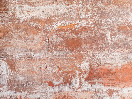 shabby old flaky red paint background. damaged crackled weathered surface. distressed abstract design. copy space concept