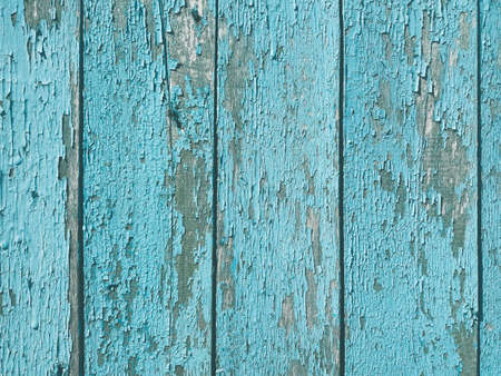 shabby old flaky wooden background. blue damaged crackled paint. weathered worn out surface. copy space concept 写真素材